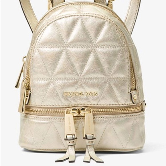 3444bab4f95a MICHAEL Michael Kors Rhea Mini Gold Backpack. M_5cba92e02f4831553c471455